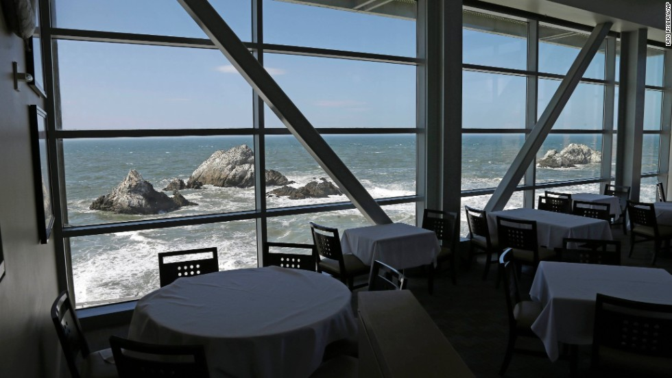 Empty tables overlooking Seal Rocks are seen inside the closed Cliff House on Wednesday, October 9, in San Francisco. The 150-year-old oceanside icon was ordered closed by the National Park Service for the duration of the partial government shutdown, leaving most of the restaurant's 170 employees without work.