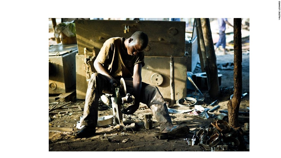 Mahamadou, 17, grinds metal parts that have just been moulded in Bamako, Mali. Every day he works from 7 a.m. to 6 p.m. recycling scrap metal to everyday objects. He never went to school and, like more than seven out of ten Malians aged 15 or older, is illiterate. His knowledge, instead, came from his father and grandfather, both of whom were blacksmiths.