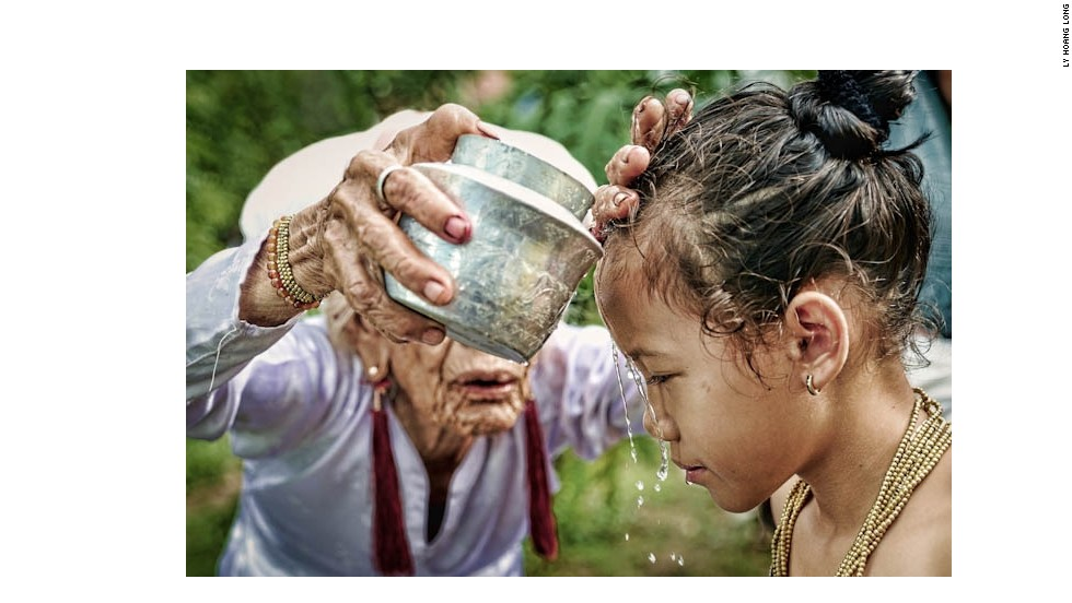 In preparation for the Karoh (maturity) ceremony, a girl is ritually purified by having water poured over her head by the most respected old woman in a Muslim community in Ninh Thuan, central Vietnam. The ceremony is considered one of the most important ritual events of their lives and the girls will then be recognized as an adult in the community.