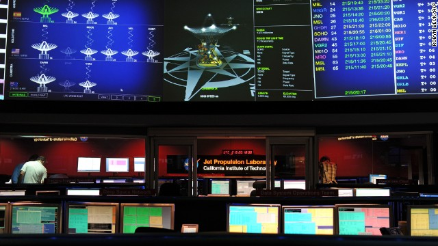 Mars Science Laboratory (MSL) mission members work in the data processing room in Pasadena, California, August 2, 2012.
