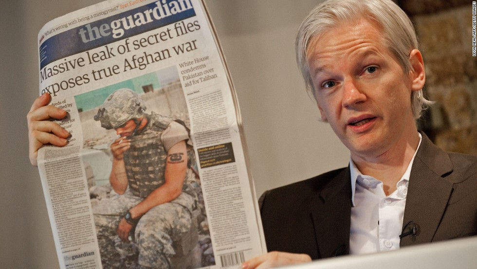 Assange holds a copy of The Guardian newspaper in London on July 26, 2010, a day after WikiLeaks posted more than 90,000 classified documents related to the Afghanistan War.