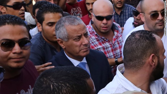 Libyan Prime Minister Ali Zeidan (C) arrives at the government headquarters in Tripoli on October 10, 2013 shortly after he was freed from the captivity of militiamen who had held him for several hours. Gunmen seized Zeidan from a hotel, where he resides, in the Libyan capital and held him for several hours before he was freed, in the latest sign of Libya's lawlessness since Moamer Kadhafi was toppled in 2011. AFP PHOTO / MAHMUD TURKIA (Photo credit should read MAHMUD TURKIA/AFP/Getty Images)