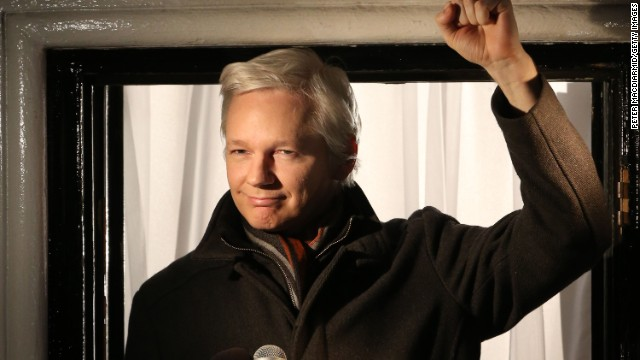 Assange speaks from a window of the Ecuadorian Embassy in London on December 20, 2012.