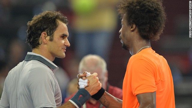Gael Monfils of France (right) shakes hands with Roger Federer after winning their third-round match at the Shanghai Masters.