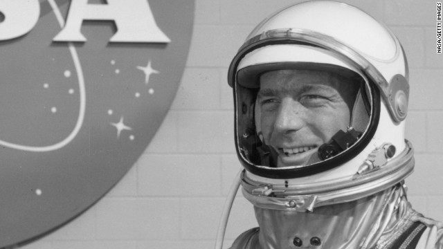 May 1962: American astronaut M Scott Carpenter stands in front of the NASA Mercury Control Center, wearing a spacesuit, Cape Canaveral, Florida. (Photo by NASA/Getty Images)