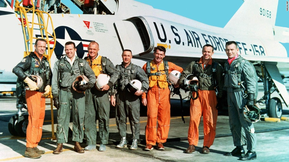 "The original seven Mercury astronauts are shown in their flight suits during training at NASA Langley Research Center in March 1961. From left: Lt. Carpenter, Capt. Gordon Cooper, Col. John H. Glenn Jr., Capt. Virgil ""Gus"" Grissom, Lt.  Cmdr. Walter Schirra, Lt. Cmdr. Alan B. Shepard Jr. and Capt. Donald  K. ""Deke"" Slayton."
