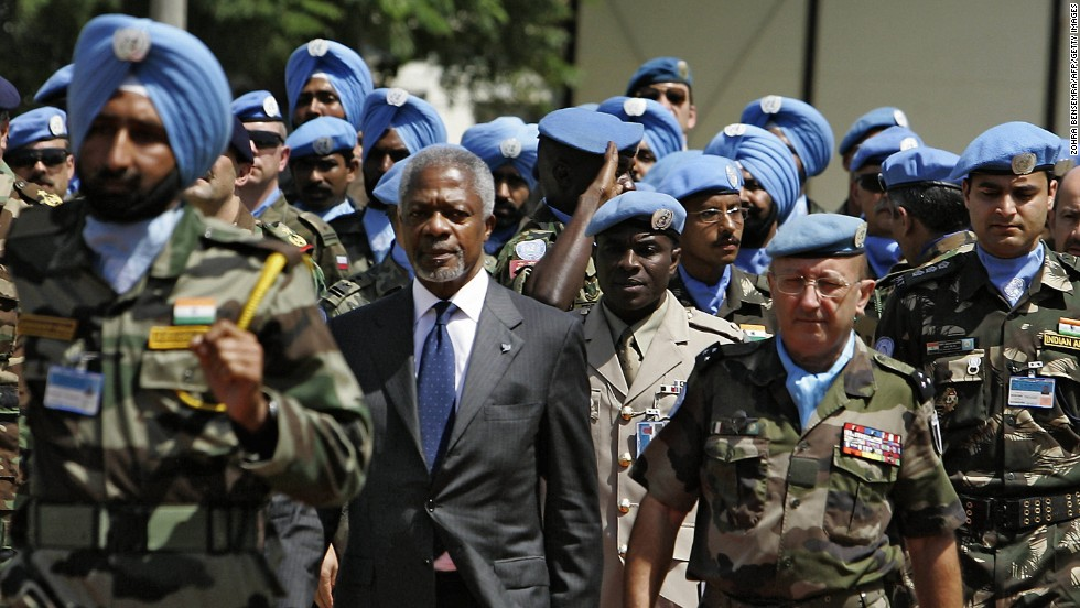 Former United Nations Secretary General Koffi Annan, center, with French Forces commander Gen. Alain Pellegrini, right, review UNIFIL soldiers upon Annan's arrival to the U.N. peacekeeping base in the southern Lebanese town of Naqura, on August 29, 2006. Annan and the United Nations won the Nobel Peace Prize in 2001.