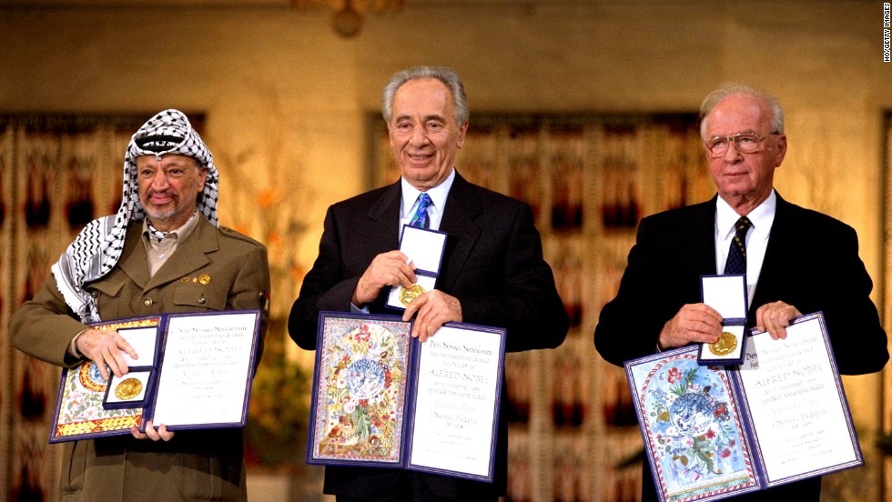 Palestinian leader Yaser Arafat, from left, Israeli Foreign Minister Shimon Peres and Israeli Prime Minister Yitzak Rabin hold up their awards after winning the Nobel Peace Prize in 1994.
