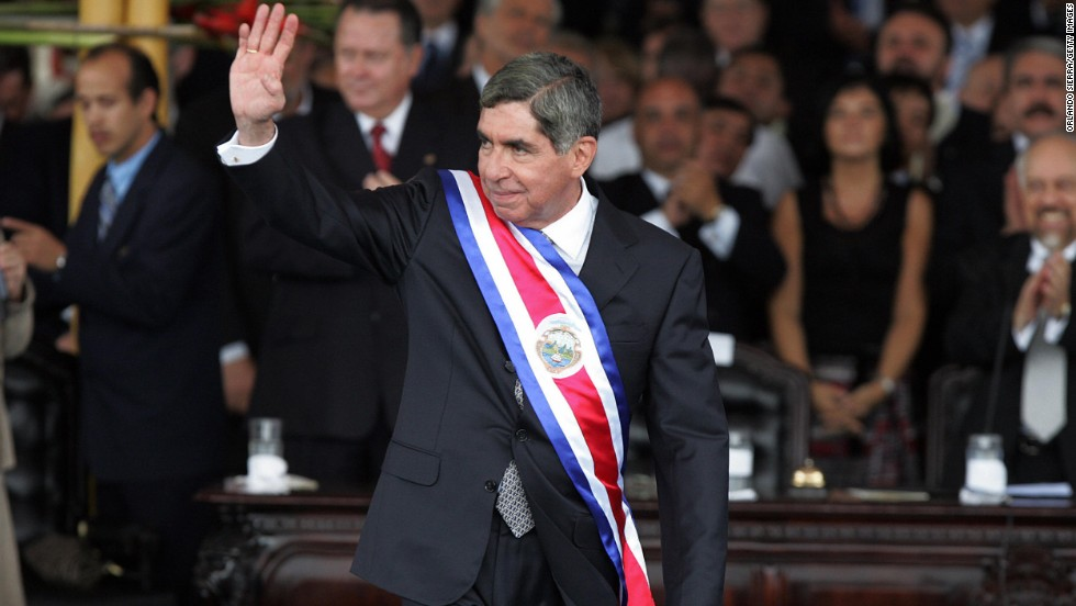 Costa Rican President-elect Oscar Arias waves to supporters after receiving the ceremonial sash at the National Stadium in San Jose on May 8, 2006. Arias won the Nobel Peace Prize in 1987.