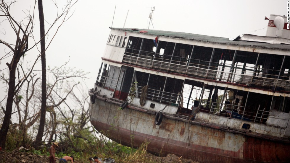 The shell of a ferry is dumped on land in Bogale by fierce winds and waves whipped by Cyclone Nargis, in a photo dated May 18, 2008. Around 140,000 people were killed across Myanmar in the country's worst ever natural disaster.