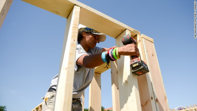 Regina Best, a U.S. Air Force veteran and AmeriCorps volunteer from Dallas, Texas, helps construct Habitat for Humanity homes at the base of the Washington Monument on the National Mall in June.