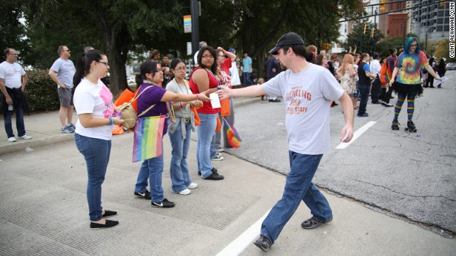 Jeremy Mullins passes out fliers at the 2012 Atlanta Pride Parade.