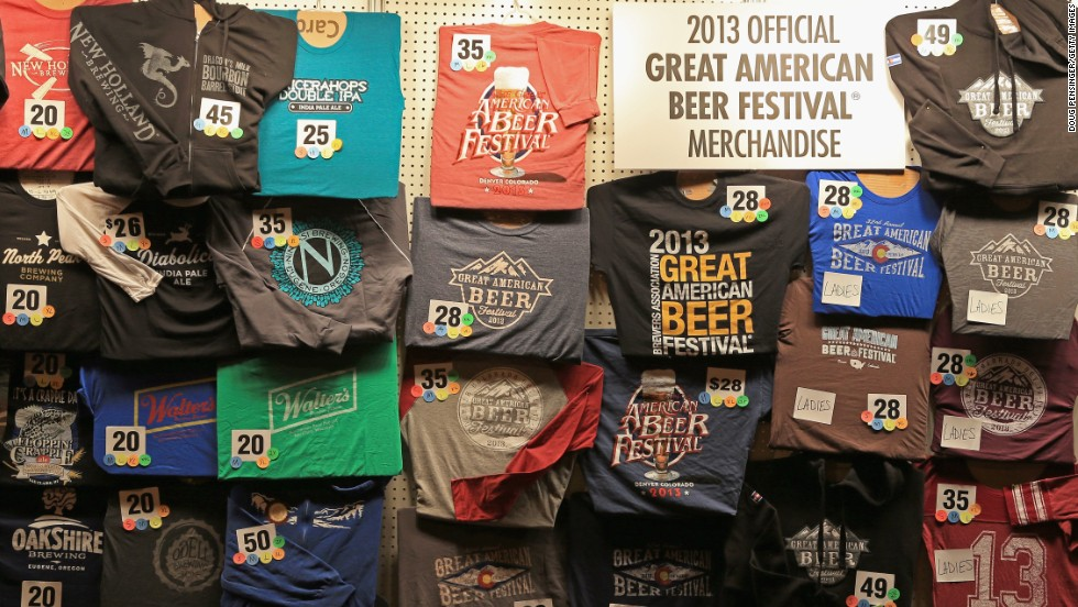 Festival goers shop for merchandise at the 32nd annual Great American Beer Festival.