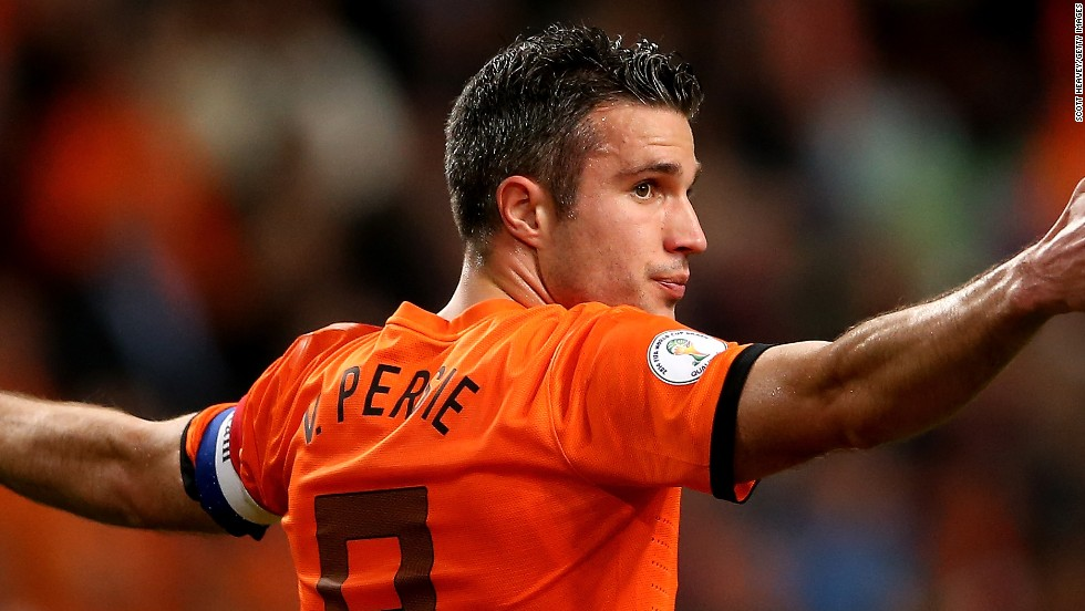 Robin van Persie scored a hat-trick in an 8-1 thrashing of Hungary by his Dutch team who have topped Group D.