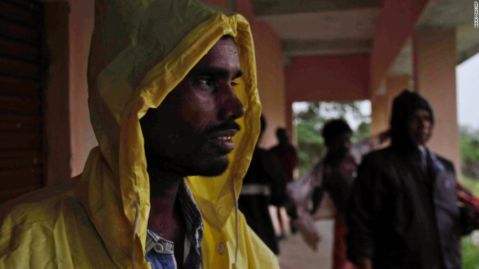 An man takes shelter at a school near Berhampur on October 12.