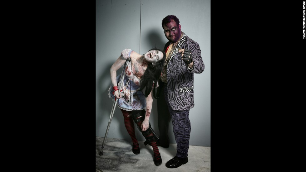 This pair attended the convention as a zombie Alice in Wonderland and Two-Face.