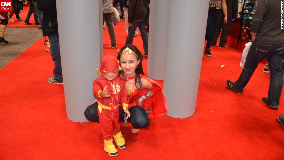 "The Flash (looking more adorable than usual here) <a href=""http://ireport.cnn.com/docs/DOC-1047486"">poses with Wonder Woman</a> (sometimes referred to as ""Mommy"")."