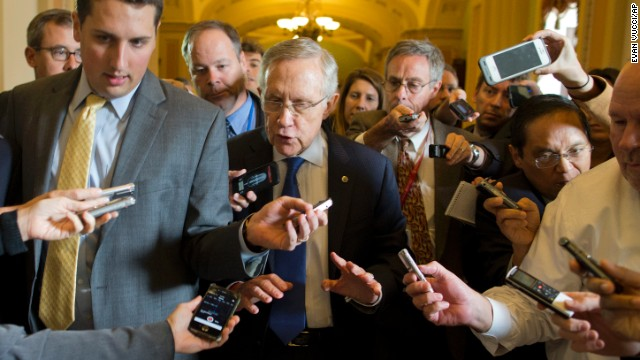 "Senate Majority Leader Sen. Harry Reid, D-Nev., is surrounded by reporters after leaving the office of Senate Minority Leader Sen. Mitch McConnell, R-Ken., on Capitol Hill on Monday, Oct. 14, 2013 in Washington. Reid reported progress Monday toward a deal to avoid a threatened default and end a two-week partial government shutdown as President Barack Obama called congressional leaders to the White House to press for an end to the impasse. ""We're getting closer,"" Reid told reporters. (AP Photo/ Evan Vucci)"