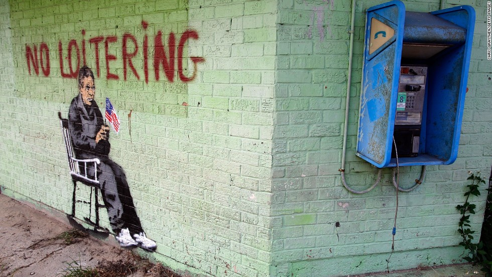 "Graffiti on the side of a building in New Orleans shows an elderly person in a rocking chair under the banner, ""No Loitering,"" in 2008."