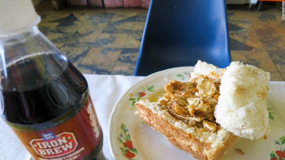 "Back in Johannesburg, Bourdain dines on ""bunny chow,"" a dish made from a hollowed out loaf of bread filled with curry."