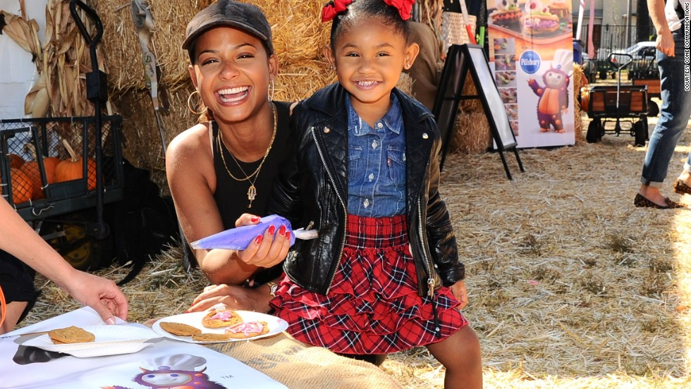 Christina Milian and daughter Violet get creative at the recent Pillsbury Make Halloween Sweet event heldat Mr. Bones Pumpkin Patch, which benefits the L.A. Regional Food Bank.