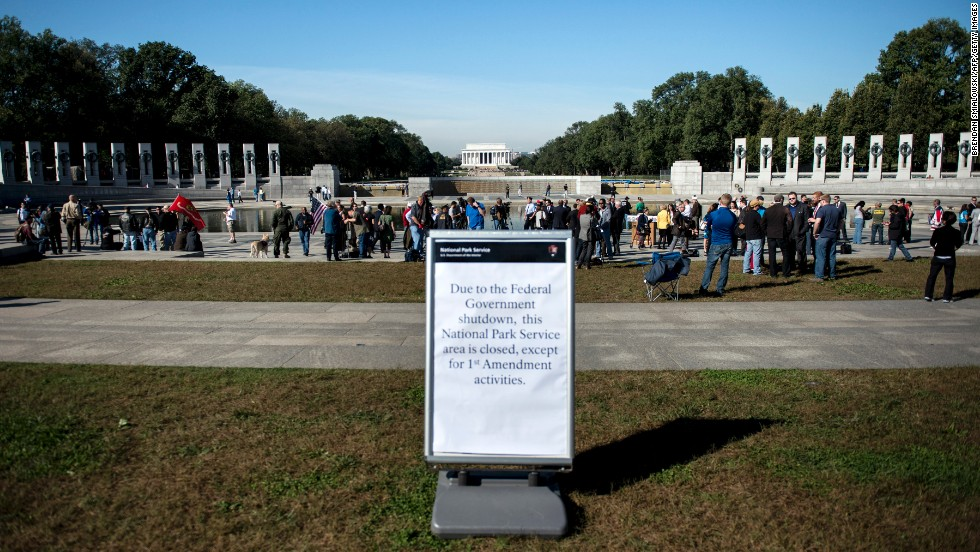 Visitors walk at the National World War II Memorial after a rally at the monument in Washington on Tuesday, October 15. Activists from veterans groups gathered to protest the partial shutdown of the U.S. government and to rally for resolutions to the budget crisis. Signs of the shutdown can be found across the country.