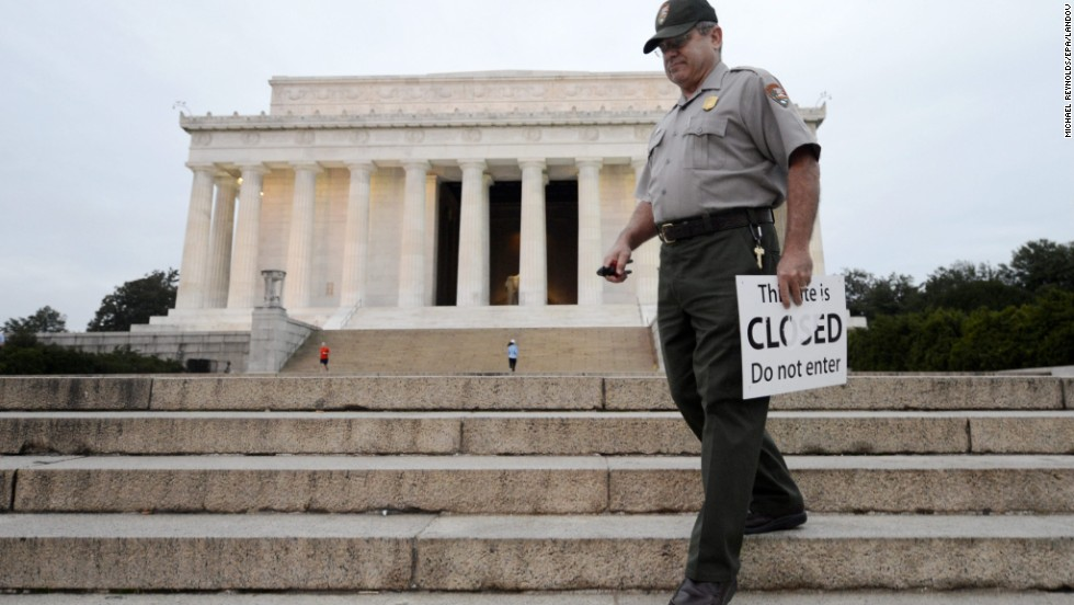 U.S. park ranger Richard Trott picks up closed signs at the Lincoln Memorial after it reopens October 17.