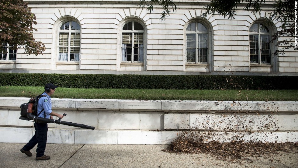 A worker blows leaves away from the Russell Senate Office Building in Washington on October 17.