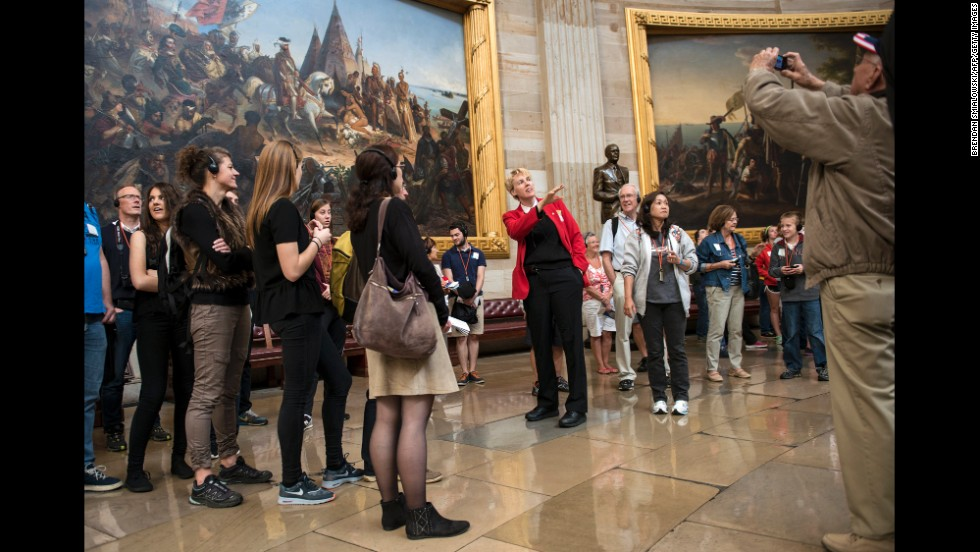 A tour guide leads tourists through the U.S. Capitol Rotunda on October 17.