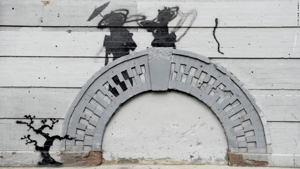 Banksy work in the Williamsburg neighborhood of Brooklyn, New York, was vandalized in broad daylight in October 2013.