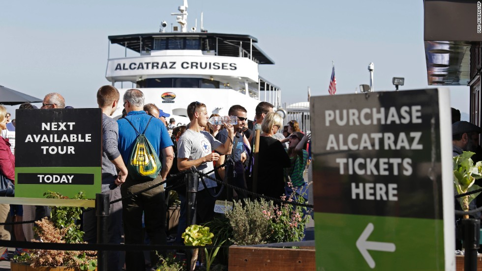 People line up for tickets to visit Alcatraz Island in San Francisco Bay on October 17.