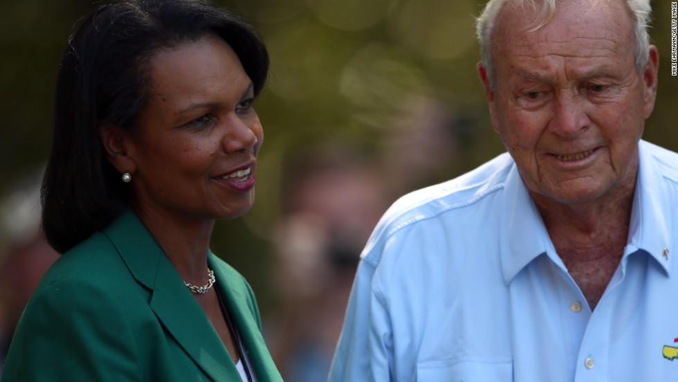Former U.S. Secretary of State Condoleeza Rice was one of two women finally admitted as members at the previously male-only Augusta National, after a long battle by anti-discrimination campaigners. Here she shares a moment with golf legend Arnold Palmer.