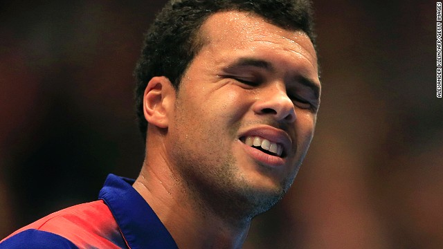 French tennis player Jo-Wilfried Tsonga grimaces during his semifinal defeat by Robin Haase in Vienna.