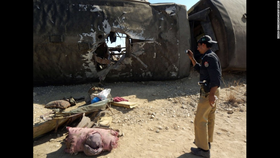 A police officer photographs the train damage on October 21.