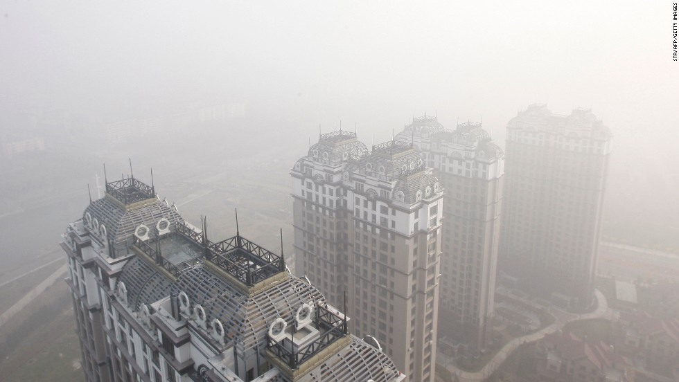 Harbin buildings are seen under heavy smog on October 22. Pollution levels there were far above international standards, the state-run China Daily reported.