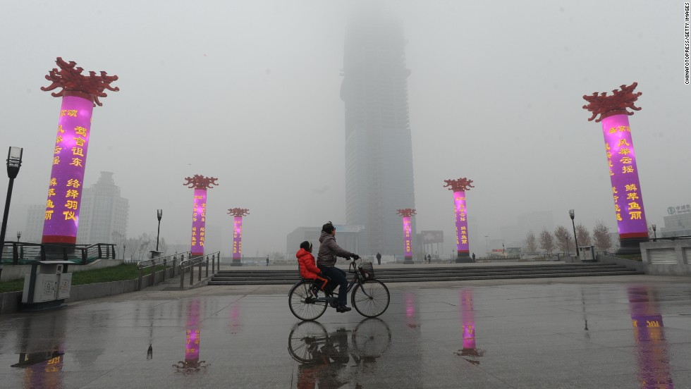 A cyclist rides along a road in Shenyang, China, on October 21.