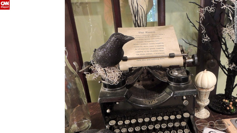 "In this close-up, you can see a raven perched atop the typewriter, and a picture of Poe and his lost love. <a href=""http://ireport.cnn.com/docs/DOC-1051000"">Hartzog's</a> blog, <a href=""http://www.therefeatheredroost.com/"" target=""_blank"">The Refeathered Roost</a>, shows more."