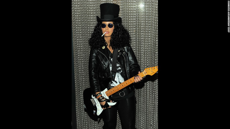 Believe it or not, that's Amber Rose under that wig and top hat. The model masqueraded as Slash at Heidi Klum's 2011 Halloween party.