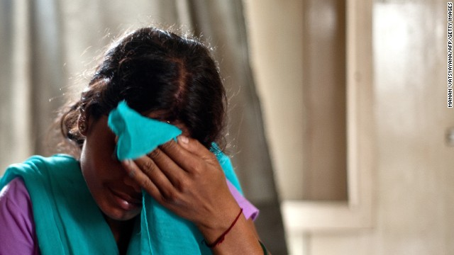 A trafficking victim sits at a police station on September 16 after being rescued from an Indian village near New Delhi.