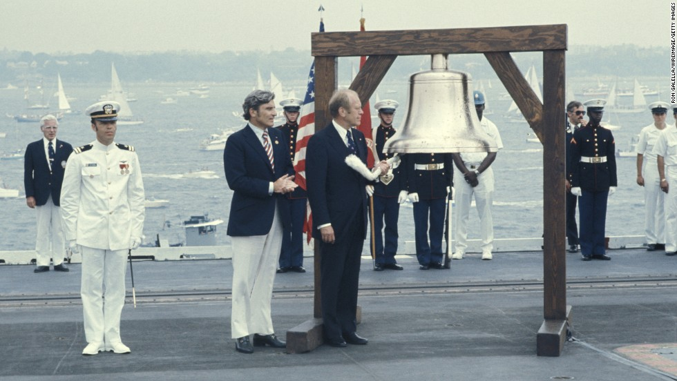 Then-President Gerald Ford stands aboard the USS Forrestal during the United States Bicentennial Celebration on July 4, 1976.