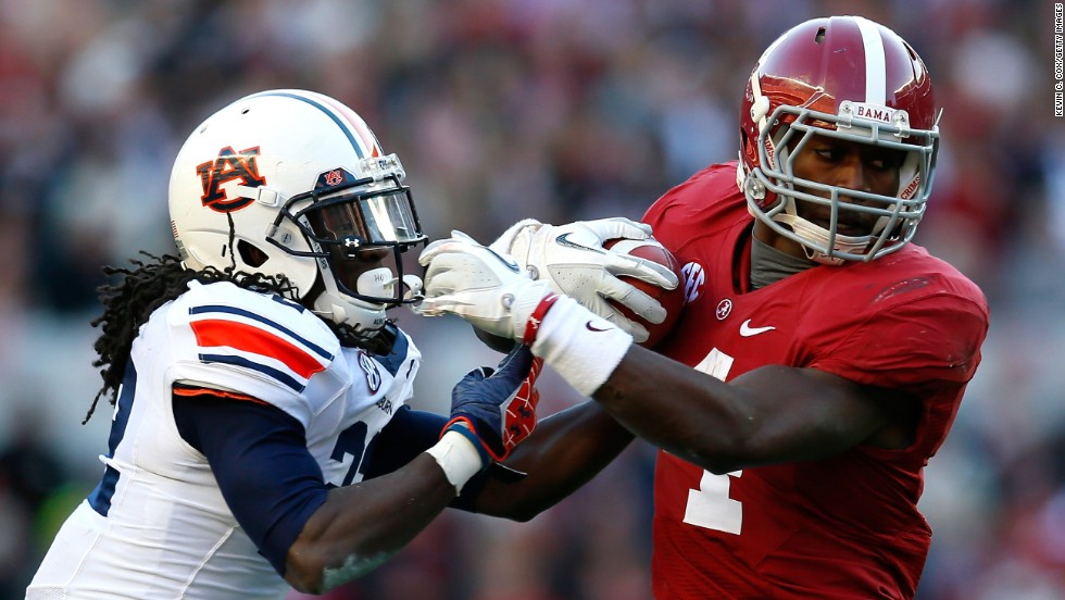 "The annual, in-state grudge match football game between Auburn University's Tigers and the University of Alabama's Crimson Tide dates to 1893 and ""basically forces people in this state to take sides the second they're born,"" according to local lore. This year's game is on November 30 at Auburn's Jordan-Hare Stadium."