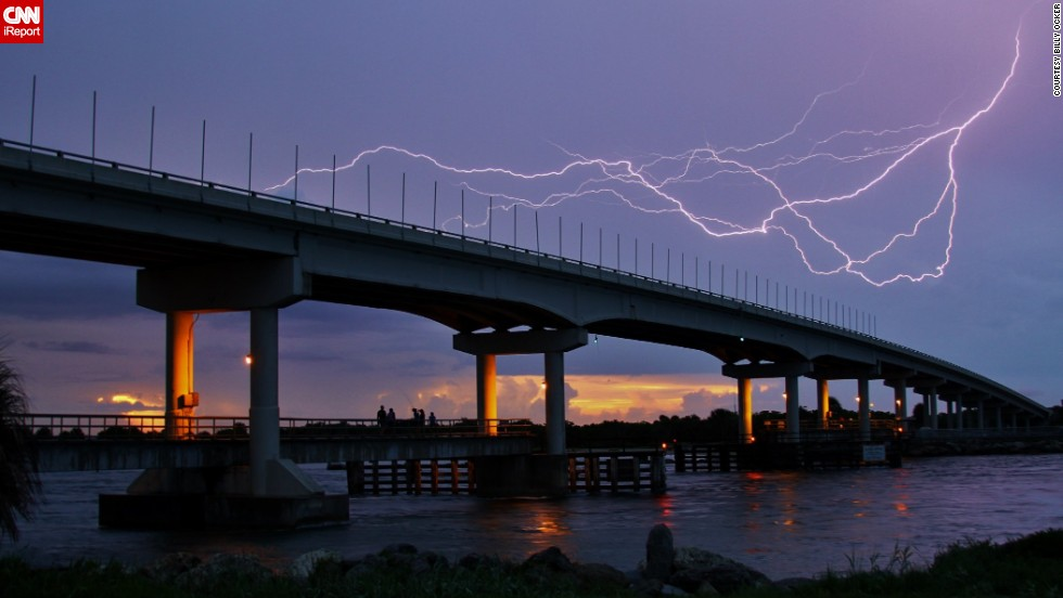 "The lightning's quick movement and the way it contrasted with the colors of the sunset caught Billy Ocker's eye in <a href=""http://ireport.cnn.com/docs/DOC-1008938"">his photo</a> from Florida's Sebastian Inlet on July 21."