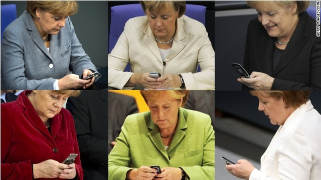 Angela Merkel uses her phone frequently.