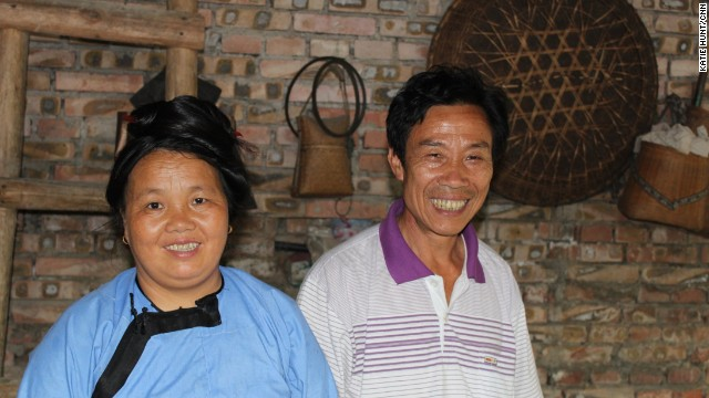 Teacher Shi, right, and his wife fear their language may be disappearing