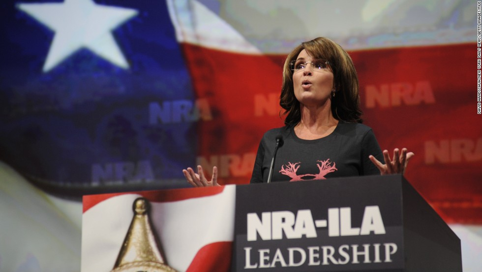 "Wearing a shirt that reads ""Women hunt,"" Palin blasts Obama and gun control advocates for ""exploiting"" recent mass shootings as she speaks to the National Rifle Association convention in Houston in May 2013."