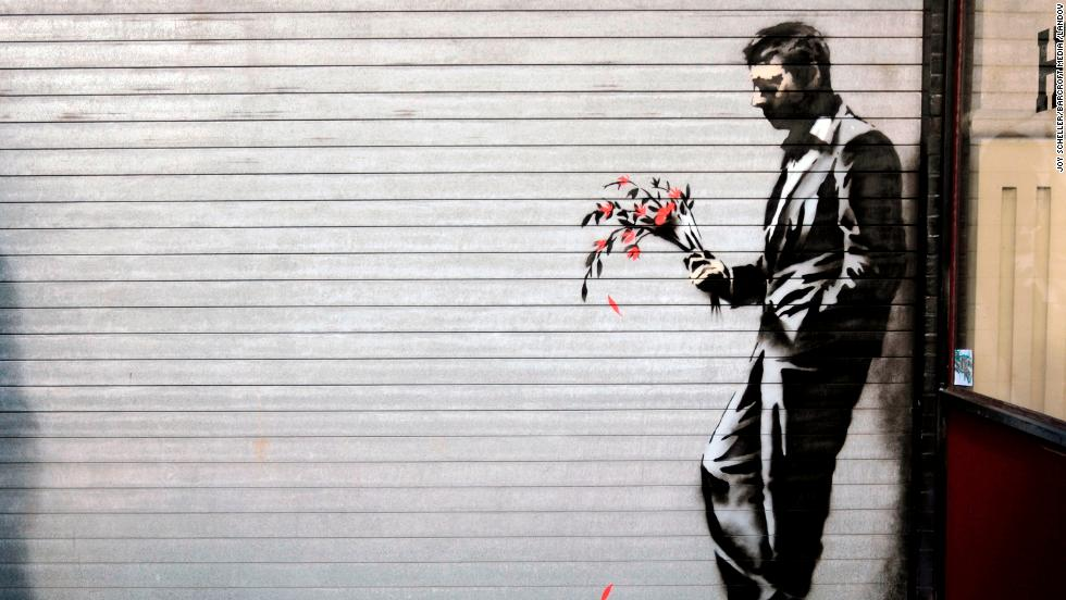 A Banksy piece covers the main entrance to Larry Flynt's Hustler Club in New York's Hell's Kitchen in October 2013.