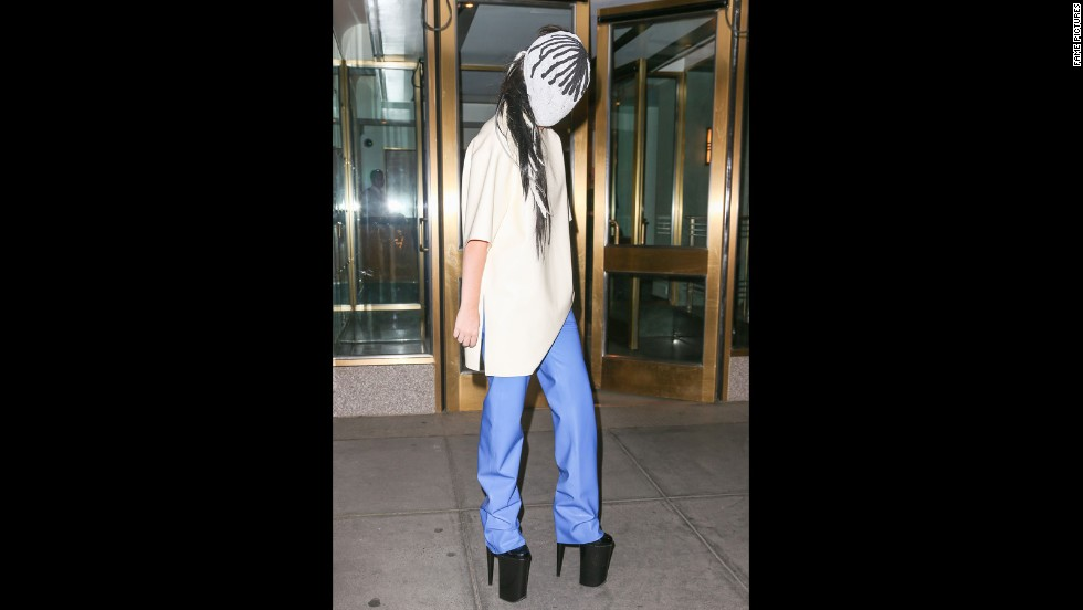 Gaga stays under cover with a mask while in New York on September 7, 2013.