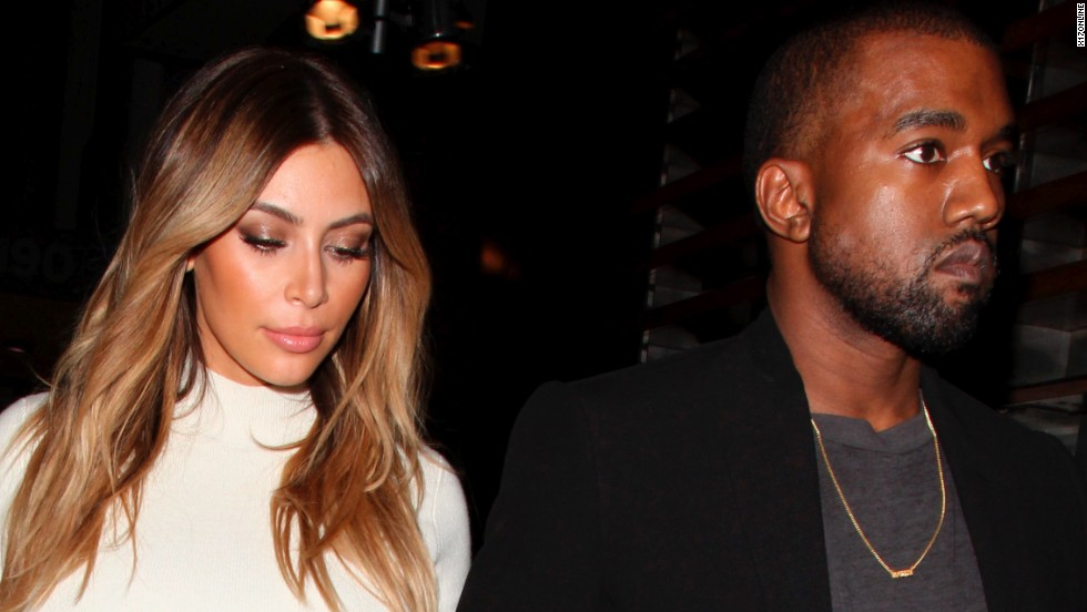Newly engaged Kim Kardashian and Kanye West go out for dinner in Los Angeles on October 24.