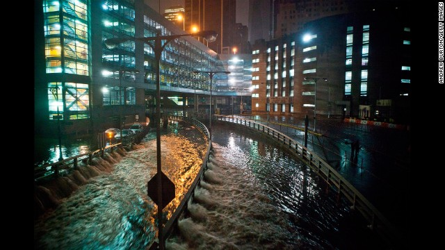Rising water caused by Superstorm Sandy rushes into the Carey Tunnel on October 29, 2012 in New York City.