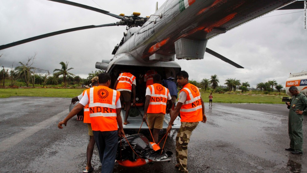 Rescue team members from the National Disaster Response Force load a chopper with rescue equipment in the Ganjam district of the eastern Indian state of Orissa on October 25.